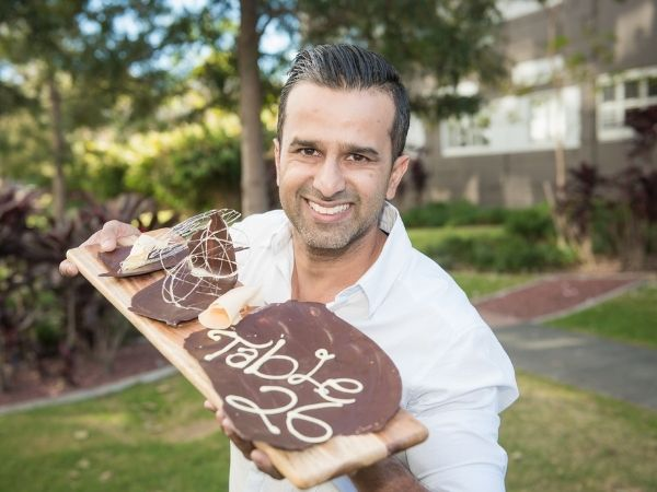 Amit holding chocolate plate